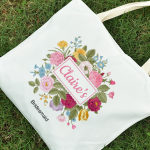 Personalised canvas tote bags as party favours.
