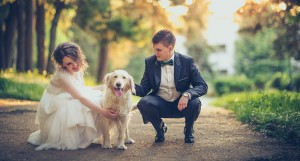 Bride and groom with their pet dog.